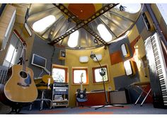 I like the idea of adding skylights to the metal roof.   NASA Grain Silo Recording Studio-mike_interior.jpg