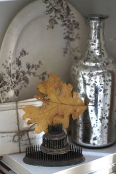 Fall leaves and mercury glass.