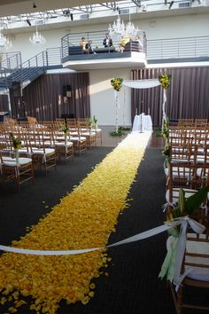 A shot showcasing the venue and our decor in its entirety.  From the flower decorated chuppah to the aisle flowers and petals.  To view our entire selection of wedding flowers visit us at www.starflor.com