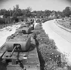 Churchill Mk IV tanks in storage on the Winchester by-pass in Hampshire, in readiness for the invasion of Europe, 16 May 1944.