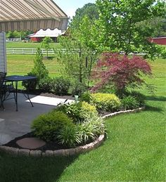 use curved landscape border, fill in with dwarf shrubs, ground cover, steeping stones and mulch/rock
