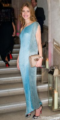 Natalia Vodianova  in an off-the-shoulder vintage Fortuny gown