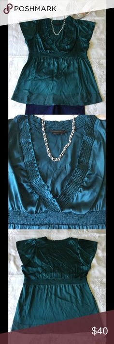 BCBGMaxAzria teal silk blouse BCBGMaxAzria teal/green silk blouse. V-neck, flutter sleeves, collar and high waist elastic accents, bottom trim matte coloring. 95% silk, 5% spandex. Excellent condition. BCBGMaxAzria Tops Blouses