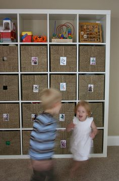 Toy organization from Ikea! We have this same set up but with dark wood instead of white.  Works great and looks great!