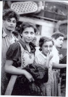 Holocaust survivors from the illegal immigrant ship Exodus . . . Can't help but notice the girl facing the camera and the hope in her eyes . . .
