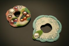 silver, resin, and wool brooches