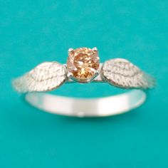 Hey, I found this really awesome Etsy listing at https://www.etsy.com/listing/219696734/golden-snitch-ring-angel-engagement-ring