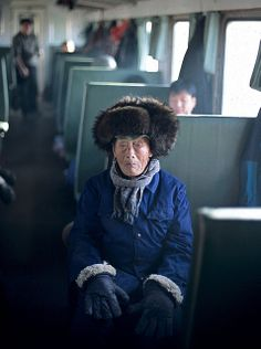 Travel Asian old man in a train china, off the beaten path.