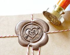 Personalized Custom Initials Wedding Heart & Arrow Wax Seal. Would be cool to do something like this for invitations etc. looks awesome.
