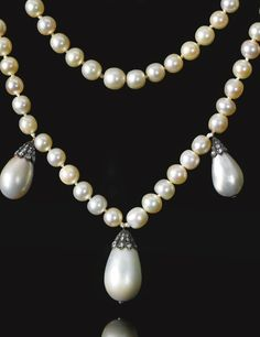Magnificent natural pearl and diamond necklace Composed of two strands of natural pearls measuring from approximately 6.25 to 8.45mm, suspending seven detachable drop shaped natural pearls, measuring from approximately 9.50 x 9.55 x 13.85mm to 14.10 x 14.85 x 21.25mm, capped with rose diamonds, the clasp set with a cushion-shaped diamond, shortest length approximately 400mm, each pearl strand detachable, fitted case, accompanied by a portrait of Queen Joséphine wearing the necklace.