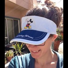 Disney Mickey Mouse Sky Blue Sun Visor Beach Hat Excellent condition. Keep that sun out of your eyes with this visor and some sunglasses while you roam the streets of Disneyland or Disneyworld. Great birthday or holiday gift. Deep blue bill. High five Mickey. Classic. Collectible. Velcro in excellent condition. 100% Cotton. Size 53 centimeters. Acc B. Disney Accessories Hats