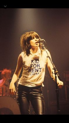 throwing a gig.  Chrissie Hynde from the rock band The Pretenders.
