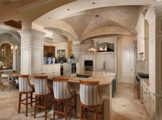 Traditional Home with groin vault ceiling and  Expert Craftsmanship in the Estates at Grey Oaks | Naples, Florida