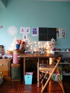 An eclectic bunch of furniture and accessories make up a cute work space. Inspiration for you study zone?