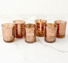 Buy in bulk -- check pricing, but color here may be better. SET OF 12 Copper Rose Gold Mercury Glass by BitsOfImperfection
