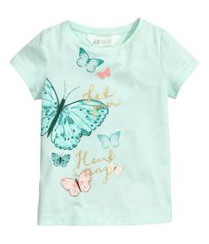Mint/butterflies. Short-sleeved top in soft cotton jersey with a printed motif at front.