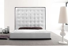 Good looking white tall upholstered headboard design
