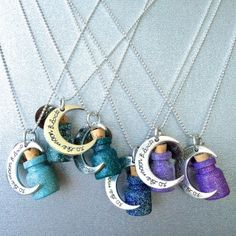 """Acrylic and Glitter Hand-Painted Glass Vials w/ Corks and Silver Moon that reads """"To The Moon And Back."""" 30'' Silver Beaded Chain."""