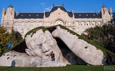 """""""Popped Up"""", a public sculpture in Budapest by Ervin Loránth Hervé of www.herveart.com description at link (h/t BoredPanda) """"Artist Ervin Loránth Hervé created an impressive sculpture called """"Popped Up"""" that depicts a giant man crawling out of the earth. The polystyrene sculpture is located at Széchenyi Square in Budapest, Hungary, and was one of the highlights for the Art Market Budapest 2014 international contemporary art fair."""""""