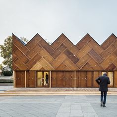 Encore Heureux has built a pavilion outside the Paris city hall featuring a facade made of reclaimed doors and insulation recycled from a supermarket roof