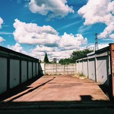 Garages en enfilade  Villeneuve d'Ascq France  . . . . . #clouds #sky #sun #beautiful #photooftheday #instagood #blue #summer #pretty #cloudporn #photography #travel #light #weather #skylovers #photo #tree #amazing #skyporn #day #view #picoftheday #instadaily #vsco #vscocam #garage #igerslille #lillemaville #perspective #shadow