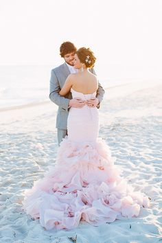 This light pink wedding dress, Divina by Maggie Sottero, is a perfect match for the sandy sunset vows of this gorgeous beach wedding. See more on Grey Likes Weddings!