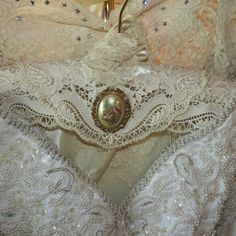 HANGER COUTURE - Rhinstone Brooch - Padded WeDDING HANGeR - Ecru Lacey Lace Trim with Flower Brooch. $45.00, via Etsy.