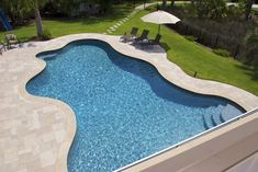 We let the creativity fly with this free form pool located in South Carolina. Swimming Pool Designs, Swimming Pools, Building A Swimming Pool, Blue Pool, Luxury Pools, Pool Builders, Spa Services, Water Features, Aqua Blue