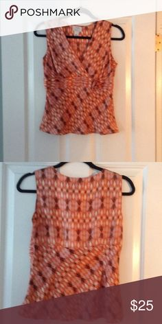 Adorable multicolored top. Ann Taylor Loft ! Adorable sleeveless top w small flower. Ann Taylor loft Tops Camisoles