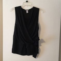 Black H&M top.  V neck, tie detail at waist. Dressy beautiful H&M top. Size 4. Worn only once H&M Tops Blouses