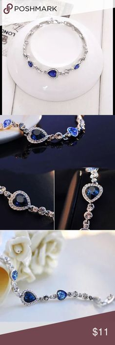 Women's blue crystal rhinestone heart bracelet Brand new in package women's blue crystal rhinestone heart charm bangle fashion bracelet.  Material, alloy rhinestone very elegant and charming Jewelry Bracelets