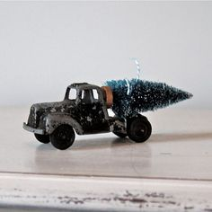 Salvage old tin toy cars and trucks with a bottle brush tree!