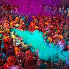 Picture showing Holi Festival. So much color! What do you think this powder is used for? Notice the big crowd, what could be happening in the picture. Possible to use to introduce festivals