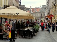 The busy cafe terrace scene on Calea Republicii in Oradea.