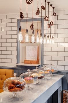 Kitchen | Edison light bulbs | subway tile | gray trim around window | tufted bench seat | wood accents