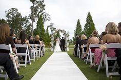 A classic Florida wedding with a white non-slip aisle runner. Pretty.