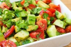 I could eat this every day and be a happy girl!  Tomato Salad with Cucumber, Avocado, Cilantro, and Lime