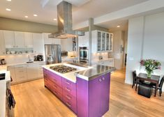 trendy L shaped kitchen idea with deep toned lavender kitchen island with extra storage white flat panel cabinetry stainless steel appliances white backsplash wood floors of 50 Inspiring Purple Theme Colour for Kitchen