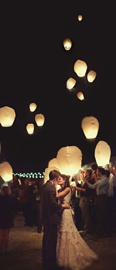 Cute illuminated balloons. Perfect for any night wedding!