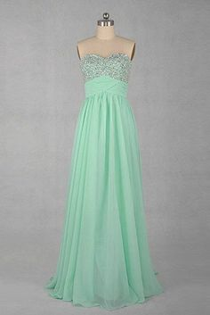 Love the color, but not really the design of the dress...