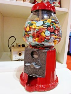 Buttons in a bubble gum dispenser, what a different great way to display your buttons.