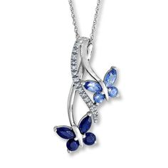 Two butterflies styled in shades of natural sapphire flutter around a spray of round diamonds in this charming necklace. This fine jewelry necklace is crafted in 10K white gold and is suspended from an 18-inch rope chain, secured with a spring ring clasp.  Sapphire is commonly subjected to enhancement processes or treatments such as heating and diffusion.  Gently clean by rinsing in warm water and drying with a soft cloth.