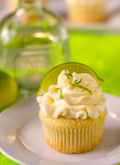 Margarita Cupcakes Ingredients For the cupcakes:  1 box white cake mix  3 egg whites  2 Tbs vegetable oil  1.5 oz triple sec  2 oz tequila of your choosing  7 oz lime juice zest of 1 lime For the ...