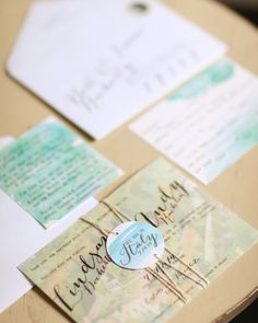 The bride-to-be designed the vellum-printed invitations with a watercolor painting of the wedding venue by Carole Poole