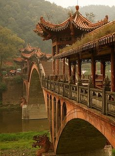 ˚Bridge - Sichuan, China* China paper dolls for free at The China Adventures of Arielle Gabriel, also Hong Kong stories at The Goddess of Mercy & The Dept of Miracles, a memoir of financial disasters and spiritual miracles in China *