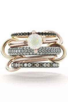 The opal stone's unique beauty makes it a great choice for the unconventional bride, or the couple looking for a less traditional engagement ring. Here, 36 stunning opal engagement rings. Unusual Rings, Unusual Jewelry, Fine Jewelry, Gold Diamond Wedding Band, Diamond Bands, Wedding Bands, Traditional Engagement Rings, Rings Cool, Ring Verlobung