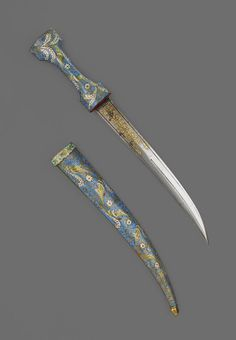19th century Persian dagger (Khanjar) its unique appearance. The blade and scabbard are of copped gilt and further decorated with palm leaf ornaments and foliage while the blade is decorated at the hilt with gold Koftgari inlay.  The Wallace Collection