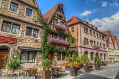 Traditional Barbarian half-timbered buildings decorated with flowering hanging baskets and Ivy growing over the buildings. You Are The World, Our World, Travel Around The World, Around The Worlds, Long Way Round, Rothenburg Ob Der Tauber, Romantic Road, Timber Buildings, Italian Lakes