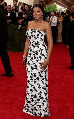 2015 Met Gala: Taraji P. Henson is wearing a white strapless Balenciaga gown with black flowers. The white dress pops against Taraji's skin tone perfectly! I love the flower design which goes with the Chinese theme. Beautiful!