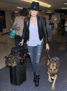 His 'n' hers hats! Nikki Reed and Ian Somerhalder are a coordinated couple in matching headwear as they arrive at LAX with pet dog | Daily Mail Online